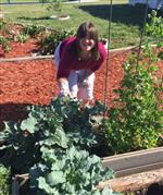 Leeza weeding the broccoli bed