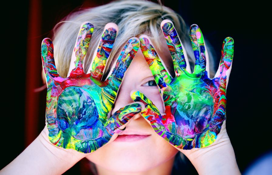 Child with paint on hands