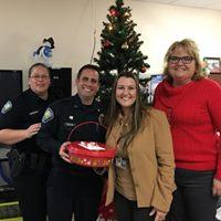 Riviera Administration delivers cookies to Palm Bay Poilce Department